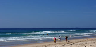 Surfers on the beach. Surfers surfing and on the beach Stock Photography