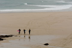 Surfers on the beach on autumnal day Royalty Free Stock Photo