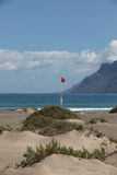 Surfers beach Famara always has a red flag. Stock Photos