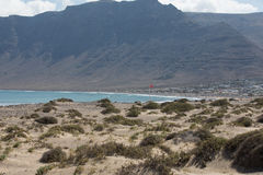 Surfers beach Famara always has a red flag. Royalty Free Stock Image