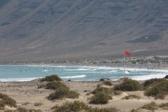 Surfers beach Famara always has a red flag. Surfers beach Famara on Lanzarote always has a red flag Stock Images