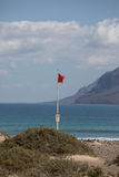 Surfers beach Famara always has a red flag. Stock Photography