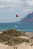 Surfers beach Famara always has a red flag. Royalty Free Stock Photo