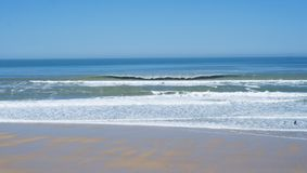 Surfers on a beach at Lacanau, France.  Royalty Free Stock Image