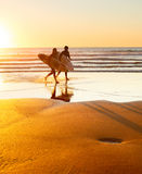 Surfers on the beach, Portugal Royalty Free Stock Photography