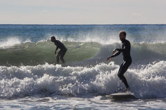 Surfers on the beach of Recco in Genoa Stock Photography