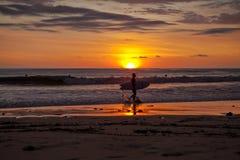 Surfers on the beach of Santa Teresa at sunset / Costa Rica Stock Image