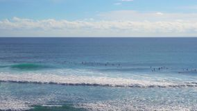 Surfers at blue point Uluwatu, Bali, Indonesia stock video