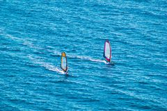 Surfers on blue sea Stock Photo