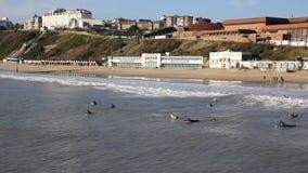 Surfers Bournemouth beach Dorset England UK near to Poole stock footage