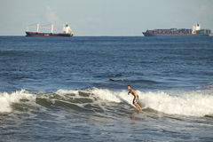 Surfers and Cargo ships, Durban Stock Photos