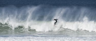 Surfers catch big waves. Along the Queensland coast, Australia, at Surfers Paradise Stock Photos