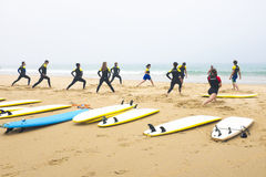 Surfers doing exercises. Before going to surf at Praia Vale Figueiras in Portugal on july 10 2013 Stock Images