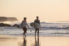 Surfers on El Cotillo beach, Fuerteventura, Canary Islands, Spain. Royalty Free Stock Image