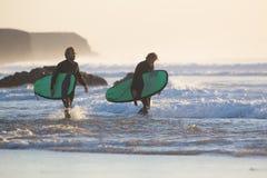Surfers on El Cotillo beach, Fuerteventura, Canary Islands, Spain. Royalty Free Stock Photos