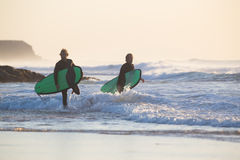 Surfers on El Cotillo beach, Fuerteventura, Canary Islands, Spain. Stock Photos