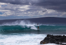 Surfers enjoy a cloudy Maui day Royalty Free Stock Photography