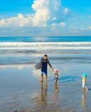Surfers family children beach. Bali stock image