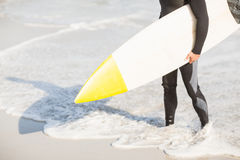 Surfers feet on the beach Royalty Free Stock Image
