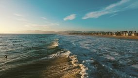Ocean waves crashing. Marina del Rey, California during sunset stock video