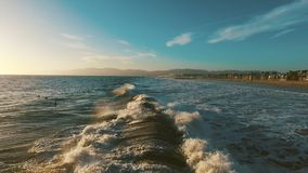Ocean waves crashing. Marina del Rey, California during sunset stock footage