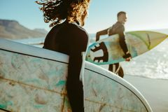 Free Surfers Going For Surfing In The Sea Stock Image - 153626891