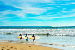 Surfers going to surf Royalty Free Stock Images