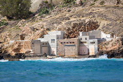 Surfers houses, Malta. Houses surfers in the bay rocky coast on the Malta island Royalty Free Stock Images