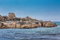 Surfers houses, Malta. Houses surfers in the bay rocky coast on the Malta island Royalty Free Stock Photo