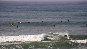 Surfers in Huntington Beach, California stock video