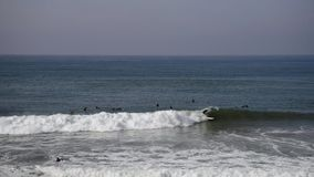 Surfers in Huntington Beach, California stock footage