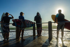 Surfers Jump Ocean Royalty Free Stock Photo