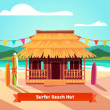 Surfers lagoon beach hut with standing surfboards Royalty Free Stock Images