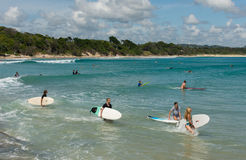Surfers looking for waves in the beach of Byron Bay. Stock Image