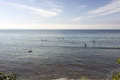 Surfers in Malibu beach, waiting for the waves in summer time in California.  Stock Photos