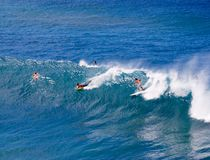 Surfers in Maui, Hawaii. Enjoying the waves royalty free stock images