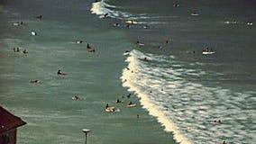 Surfers of Noordhoek Beach in 1980s. Aerial view of Noordhoek Beach. Surfing in Cape Town. Surfers riding big waves of Atlantic coast in Table Mountain National stock footage