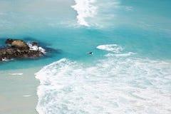 Surfers at Noordhoek Beach stock photography
