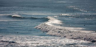Surfers in ocean Stock Photography