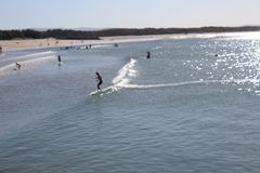 Surfers on Ocean at Noosa royalty free stock photo