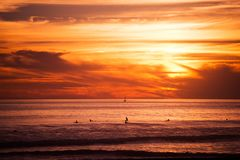 Surfers and the Ocean. Southern California Ocean Sunset with Surfers Awaiting Big Wave Stock Image