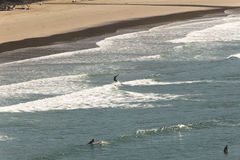 Surfers off the coast of Oregon Royalty Free Stock Photos