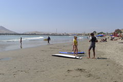 Surfers in one Cerro Azul beach at the south of Lima Stock Photos
