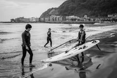 Surfers on the Pacific beach of Kamakura, Japan Stock Images