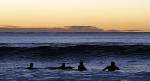 Surfers Paddling Out Stock Photography