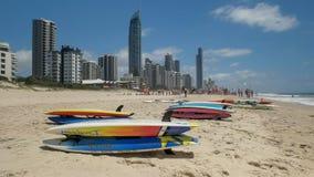 SURFERS PARADISE, AUSTRALIA- DECEMBER, 4, 2016: paddle boards on the beach at surfers paradise. SURFERS PARADISE, AUSTRALIA- DECEMBER, 4, 2016: close up of a royalty free stock photo
