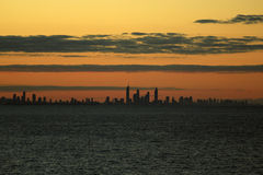 Surfers Paradise in distance at sunset time Royalty Free Stock Image