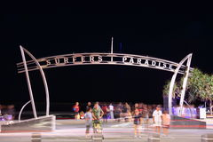 Surfers Paradise gate by night. Blurred illustration of people passing through the gate of Surfers Paradise (Gold Coast, Australia) at night. Long Royalty Free Stock Photo