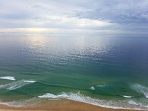 Surfers paradise. Sun sneaking rhrough the clouds Stock Image