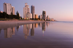 Surfers paradise sunrise. Surfers Paradise reflecting in the beach at sunrise Stock Images